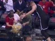 Thể thao - Chạy quá đà, Sao NBA cho khán giả ''tắm bia''