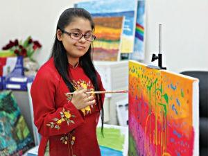Cô bé mắc bệnh down trở thành thiên tài hội họa