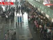 """Thị trường - Tiêu dùng - """"Đại dịch"""" vé giả, cò vé tàu xe Tết bùng phát ở Hà Nội"""