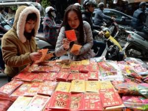 Thế giới - Mỗi hộ gia đình Việt chi 14 triệu cho Tết Nguyên Đán