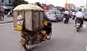 Tin tức Việt Nam - Không buộc người dân nộp xe máy, ô tô hết niên hạn