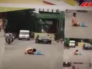 Video An ninh - Nam thanh niên trần truồng ngồi giữa phố Hà Nội cầu mưa