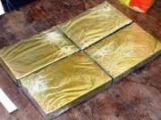 An ninh Xã hội - Đóng giả khách du lịch mang 4 bánh heroin từ Lào về VN