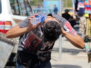 Thế giới - Ảnh: Dân Iraq oằn mình chống chọi nắng nóng khủng khiếp