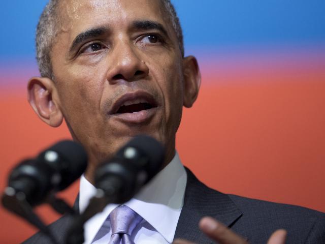 Lần đầu tiên thăm Lào, Obama cam kết chi 2.000 tỉ đồng