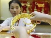 Tài chính - Bất động sản - Vàng tiếp tục giảm theo giá USD