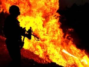Thế giới - TQ dùng súng phun lửa lùa khủng bố Tân Cương ra khỏi hang