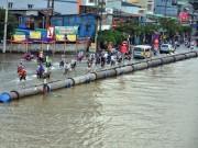 Đường sóng sánh nước, người Sài Gòn bì bõm lội về nhà