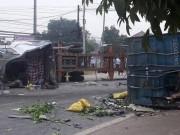 HN:Thùng xe container văng xuống đường, 2 người tử nạn