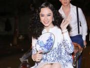 Angela Phương Trinh  '  ' cưỡi '  '  xích lô, đội mưa dự sự kiện