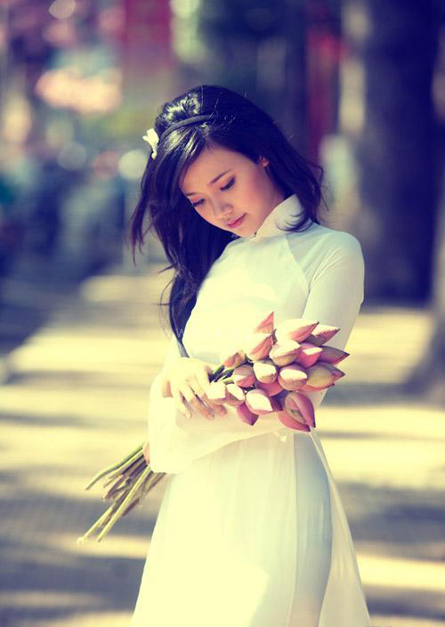 Hot girl Midu dịu dàng trong trang phục áo dài - 13