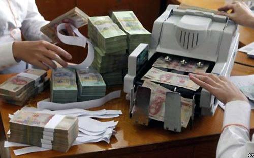 Ngân hàng phải chi thêm tiền để xử lý nợ xấu - 1