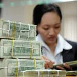 Tài chính - Bất động sản - Điều chỉnh tỷ giá có hại thế nào?