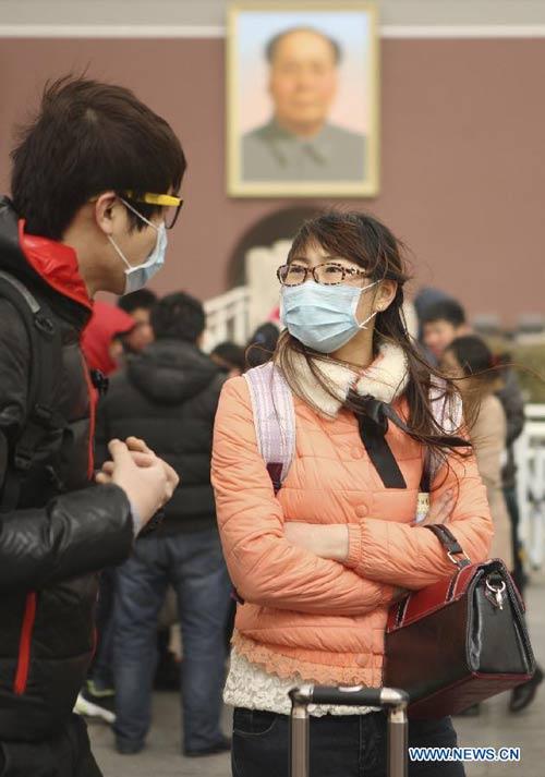 Chùm ảnh: Bão cát, khói bụi tấn công Bắc Kinh - 3