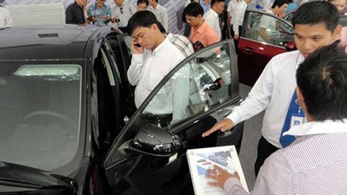 Cấm mua xe bằng tiền mặt sẽ không còn xa - 1