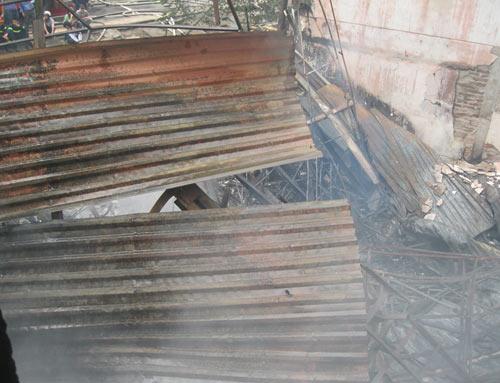 Hoang tàn sau đám cháy nhà 5 tầng - 11