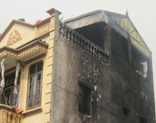 Hoang tàn sau đám cháy nhà 5 tầng - 12