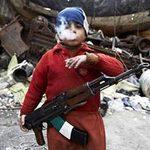"""Tin tức trong ngày - Hình ảnh """"sốc"""" về chiến binh 7 tuổi ở Syria"""