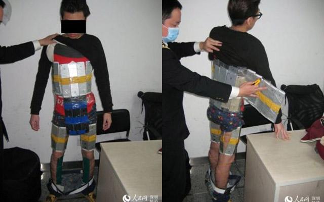 Hồng Kông: Dán gần 100 chiếc iPhone trên người để buôn lậu - 1