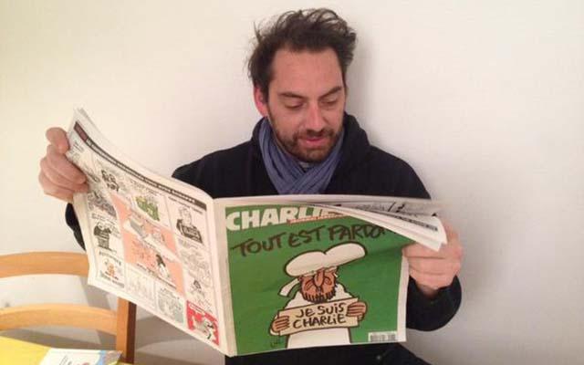 Người Pháp xếp hàng từ mờ sáng mua số mới của Charlie Hebdo - 10