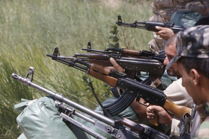 IS cải trang làm binh sĩ Iraq tấn công trại lính Mỹ - 1