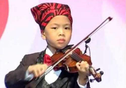 Cậu bé 11 tuổi đa tài nhất thế giới - 3
