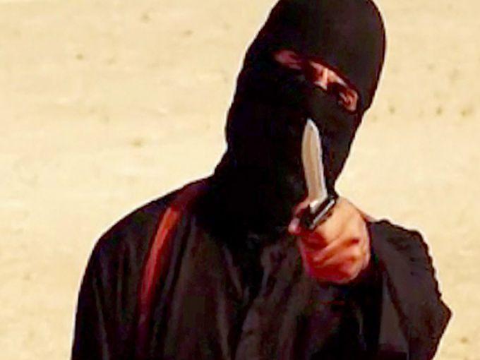 Tên đao phủ khét tiếng của IS bị vạch mặt - 1