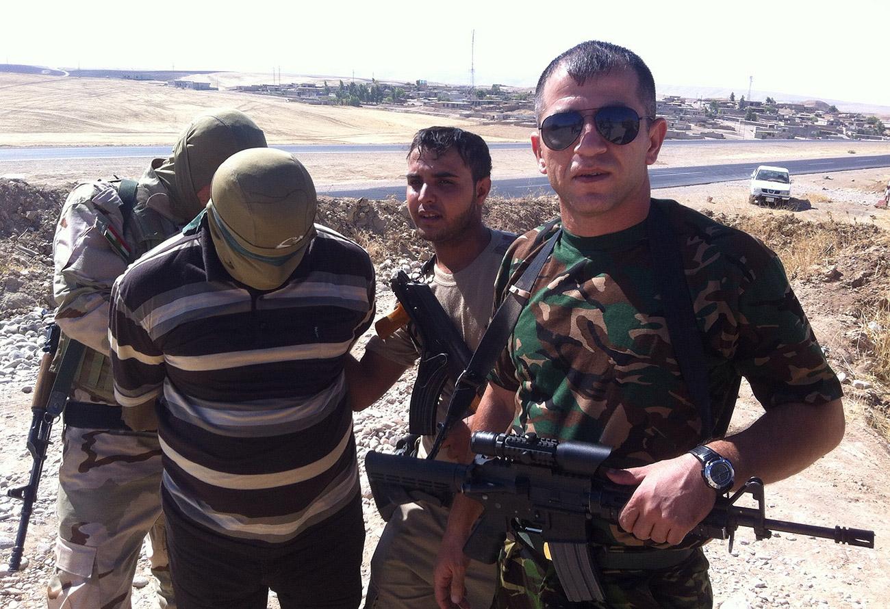 """Phiến quân IS """"lừa mẹ già ăn thịt con trai"""" - 1"""