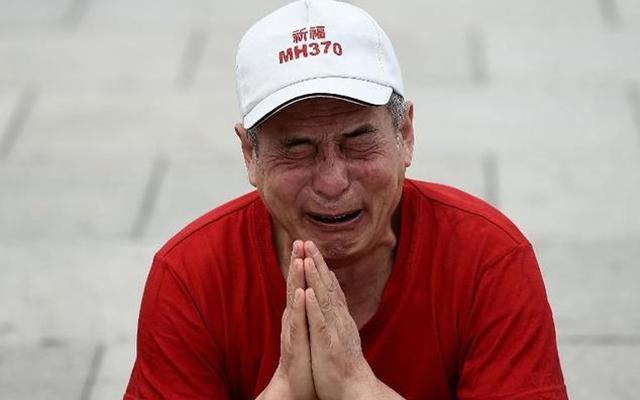 Một năm MH370: Ám ảnh nỗi đau và những cơn giận dữ - 1