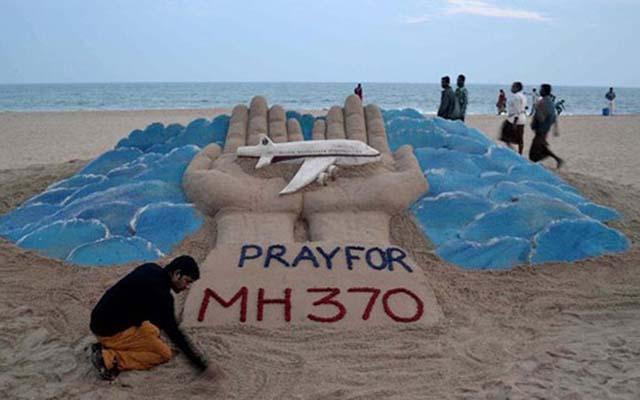 1 năm MH370: Những ông bố một mình chăm con - 3