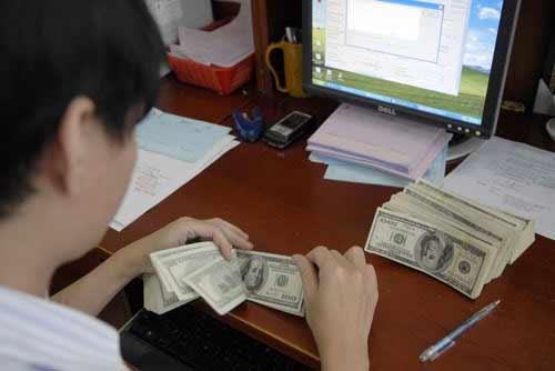 Tăng tỷ giá USD 1%, nợ nước ngoài tăng 10.000 tỷ đồng - 1