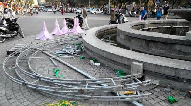 Đã tháo dỡ hoa trang trí ở đài phun nước hồ Hoàn Kiếm - 3