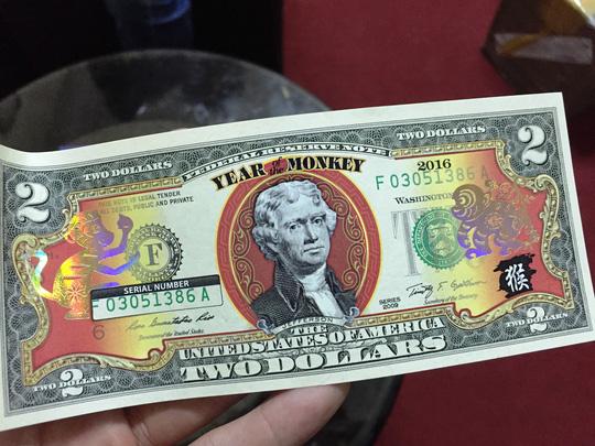 Đồng xu mạ vàng in hình khỉ giá 3 triệu đồng - 4
