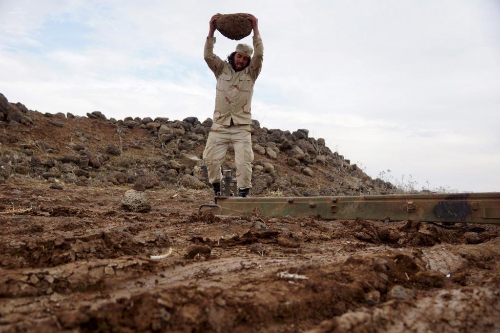 """Ảnh: Bên trong """"thị trấn xác sống"""" ở Syria - 7"""
