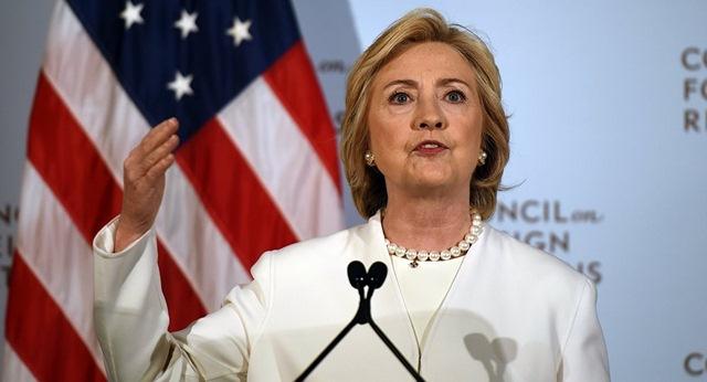 """Bà Clinton: Putin """"ỷ lớn hiếp bé"""" - 1"""