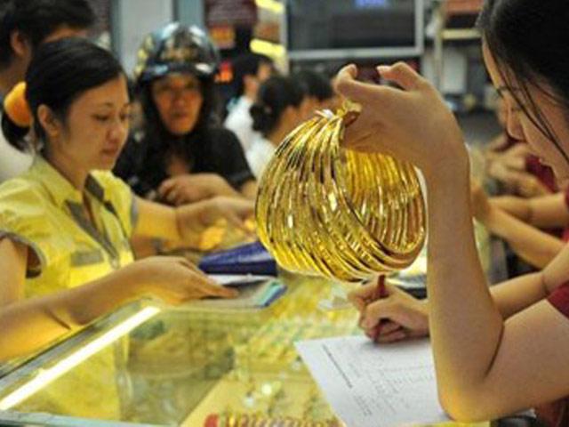 Vàng và USD dắt tay nhau cùng giảm mạnh - 1