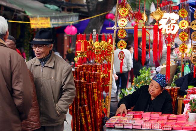 Ảnh: Sắc màu chợ hoa xuân phố cổ ngày cận Tết - 11