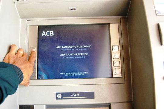 90% giao dịch là rút tiền, hỏi sao ATM không quá tải? - 2