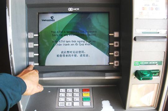 90% giao dịch là rút tiền, hỏi sao ATM không quá tải? - 1