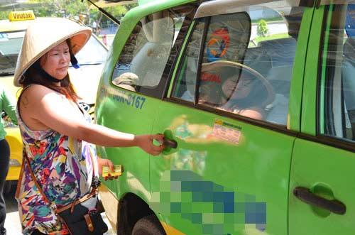 TP HCM: Nhiều hãng taxi giảm cước 500-700 đồng/km - 1