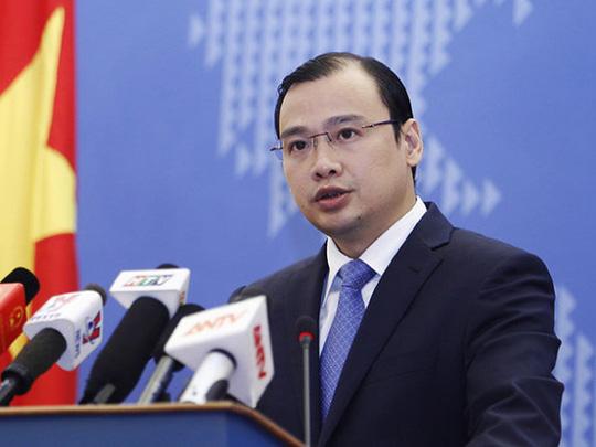 Việt Nam phản ứng việc TQ đưa máy bay ra Hoàng Sa - 1