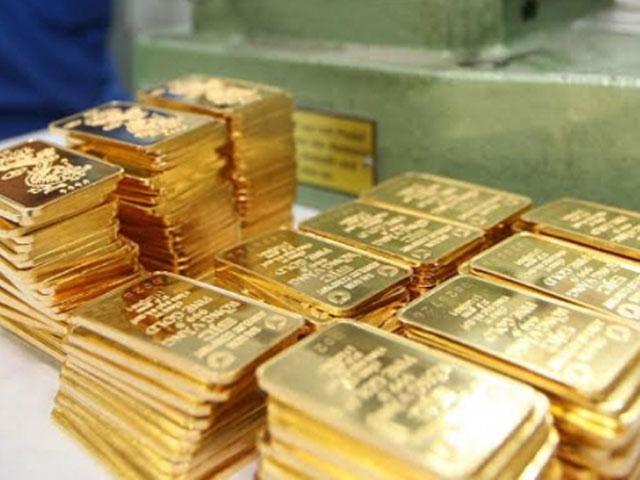 Giá vàng sẽ còn leo cao trong tuần tới - 1
