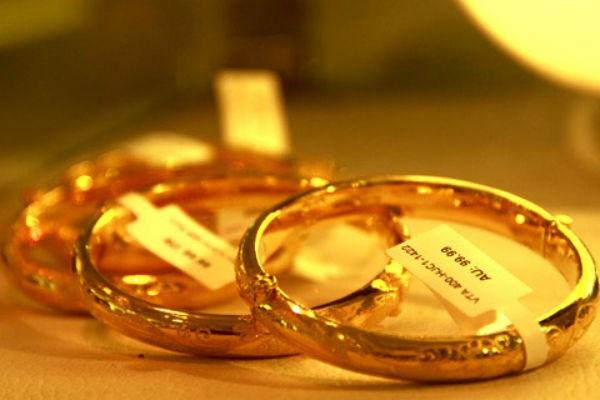Giá vàng hôm nay 8/3 tăng gần 100.000 đồng/lượng - 1