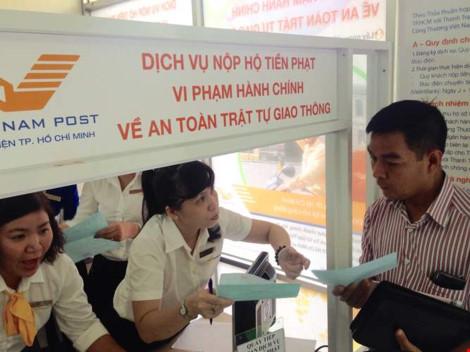 Nộp phạt vi phạm giao thông qua bưu điện: 15 phút là xong - 1