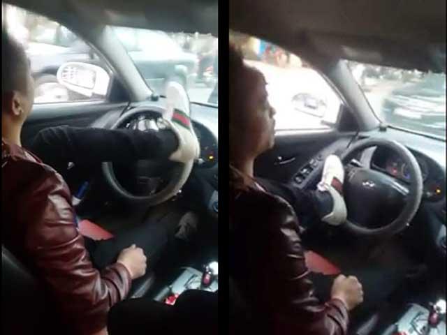 Tài xế lái ô tô bằng chân sẽ không bị xử phạt? - 1
