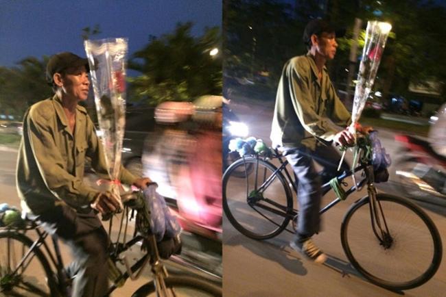 Hình ảnh người đàn ông đi trên chiếc xe đạp, tay cầm đóa hoa hồng để tặng vợ nhân ngày Phụ nữ Việt Nam 20.10 của tác giả Hồng Phú.