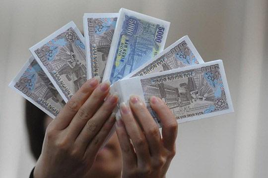 Cấm đổi tiền mới để hưởng chênh lệch - 1