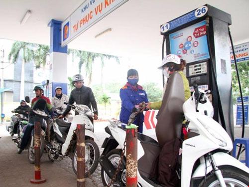 1 lít xăng sẽ gánh 8.000 đồng thuế bảo vệ môi trường - 1