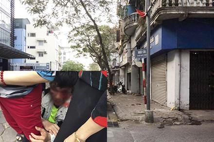 Nghi trộm xe SH, 3 người bị đánh trên phố - 1
