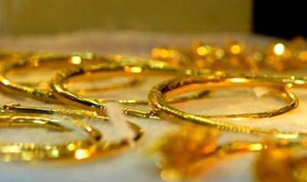 Giá vàng hôm nay 13/2: Giá vàng bất ngờ giảm, tỷ giá trung tâm tăng mạnh - 1